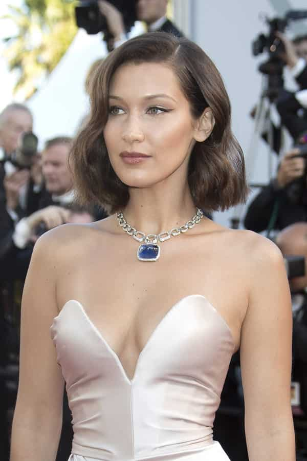 bella hadid beautiful red carpet white low cut dress revealing clevage