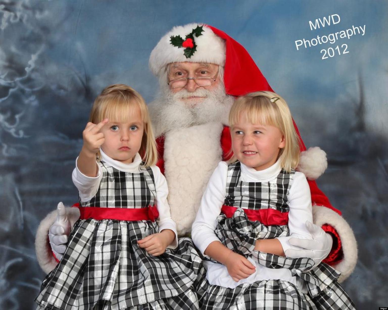 funny santas lap middle finger - Free funny santa photos