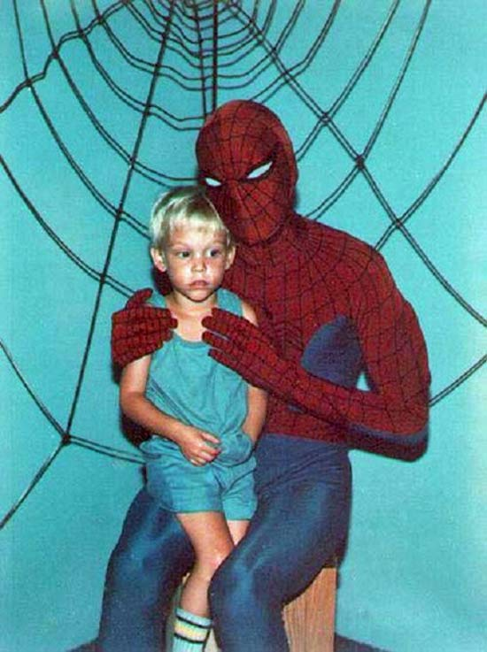 vintage-snapshot-kid-sitting-on-creepy-spider-mans-lap-funny-family-portraits