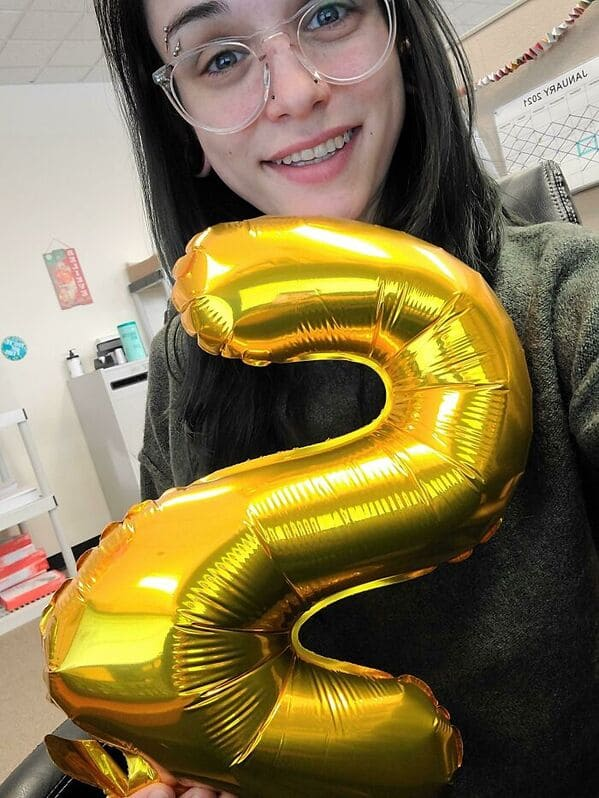 woman holding balloon with number two on it, glasses, Uplifting wholesome images, nice pictures of animals and people, humanity restored, wholesome pics, reddit, r wholesome, funny cute animals, feeling good